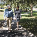 man in turban walking in a park with a woman