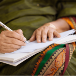 woman with notebook on her lap